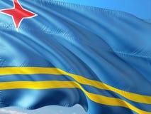 Flaga Aruba falowanie w wiatrze przeciw g??bokiemu niebieskiemu niebu Wysokiej jako?ci tkanina obrazy royalty free