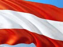Flaga Austria falowanie w wiatrze przeciw g??bokiemu niebieskiemu niebu Wysokiej jako?ci tkanina fotografia royalty free