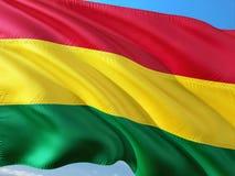 Flaga Boliwia falowanie w wiatrze przeciw g??bokiemu niebieskiemu niebu Wysokiej jako?ci tkanina zdjęcia stock