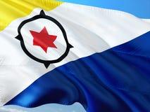 Flaga Bonaire falowanie w wiatrze przeciw głębokiemu niebieskiemu niebu Wysokiej jako?ci tkanina obraz royalty free