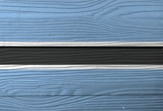 Flaga Botswana na drewnianym ściennym tle Grunge Botswana flagi tekstura fotografia royalty free