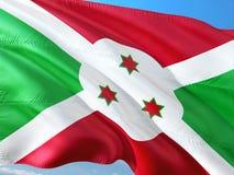 Flaga Burundi falowanie w wiatrze przeciw g??bokiemu niebieskiemu niebu Wysokiej jako?ci tkanina fotografia royalty free