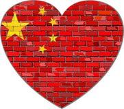 Flaga Chiny na ściana z cegieł w kierowym kształcie Fotografia Royalty Free