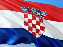 Flaga Chorwacja falowanie w wiatrze przeciw g??bokiemu niebieskiemu niebu Wysokiej jako?ci tkanina zdjęcie stock