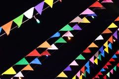 Flaga dla dekoruje w wigilii odizolowywa na czarnym tle Obrazy Royalty Free