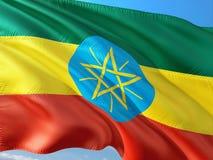 Flaga Etiopia falowanie w wiatrze przeciw g??bokiemu niebieskiemu niebu Wysokiej jako?ci tkanina zdjęcie royalty free