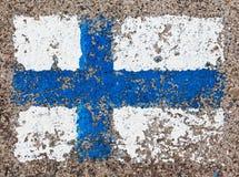 Flaga Finlandia na betonowej ścianie Zdjęcie Royalty Free