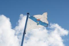 Flaga Galicia falowanie na niebie fotografia royalty free