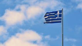 Flaga Grecja latanie w wiatrze i niebieskim niebie Lata tło dla podróży i wakacji crete Greece Fotografia Stock