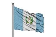 Flaga Gwatemala falowanie w wiatrze, odosobniony biały tło Gwatemalska flaga zdjęcia royalty free