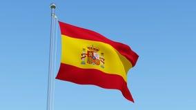 Flaga Hiszpania falowanie przeciw niebieskiemu niebu Zdjęcia Stock