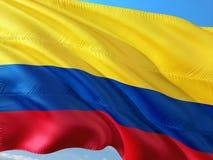 Flaga Kolumbia falowanie w wiatrze przeciw g??bokiemu niebieskiemu niebu Wysokiej jako?ci tkanina zdjęcia royalty free