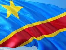 Flaga Kongo falowanie w wiatrze przeciw g??bokiemu niebieskiemu niebu Wysokiej jako?ci tkanina obraz stock