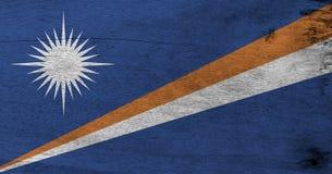 Flaga Marshall wyspy na drewnianym półkowym tle Grunge Marshall flagi tekstura zdjęcie royalty free