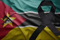 Flaga Mozambique z czarnym opłakuje faborkiem Zdjęcia Stock