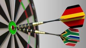 Flaga Niemcy i Południowa Afryka na strzałkach uderza bullseye cel Międzynarodowy współpraca lub rywalizacja Obrazy Royalty Free