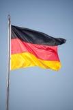 Flaga Niemcy w wiatrze Obrazy Stock