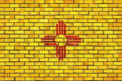 Flaga Nowy - Mexico na ściana z cegieł Fotografia Royalty Free