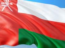 Flaga Oman falowanie w wiatrze przeciw g??bokiemu niebieskiemu niebu Wysokiej jako?ci tkanina zdjęcia stock