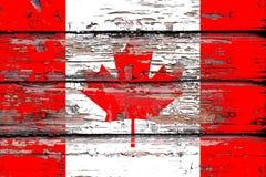 Flaga państowowa Kanada na drewnianym tle fotografia stock
