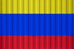 Flaga państowowa Kolumbia na ogrodzeniu zdjęcia royalty free