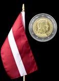 Flaga państowowa Latvia i euro moneta Fotografia Stock