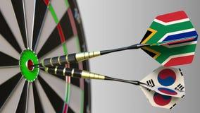 Flaga Południowa Afryka i Korea na strzałkach uderza bullseye cel Międzynarodowy współpraca lub rywalizacja Zdjęcia Stock