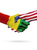 Flaga Stany Zjednoczone i gwinei kraje, overprinted uścisk dłoni Obrazy Royalty Free