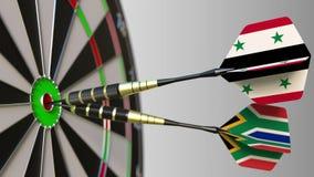 Flaga Syria i Południowa Afryka na strzałkach uderza bullseye cel Międzynarodowy współpraca lub rywalizacja Zdjęcia Royalty Free