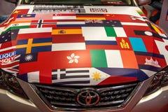 Flaga wszystkie narodu Chongqing Auto przedstawienie Toyota na kapiszonie Obrazy Royalty Free