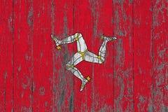 Flaga wyspa mężczyzna malował na przetartym za drewnianym tekstury tle zdjęcia royalty free