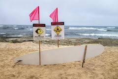 Coastal hazard signs high surf, storng curent Rescuse board, pin Stock Image