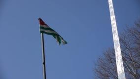 Flagga av Abchazien på vind arkivfilmer