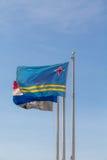 Flagga av Aruba på flaggstång Fotografering för Bildbyråer