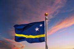 Flagga av Aruba på solnedgången Royaltyfri Foto