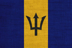 Flagga av Barbados på gammal linne Royaltyfri Foto