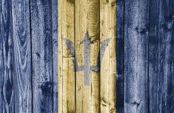 Flagga av Barbados på ridit ut trä Royaltyfri Bild