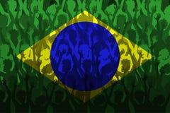 Flagga av Brasilien över stöttande fans Royaltyfri Bild