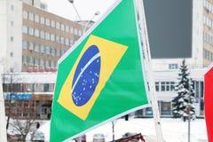 Flagga av Brasilien i stad Arkivbilder