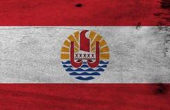 Flagga av franska Polynesien på träplattabakgrund För franska Polynesien för Grunge textur flagga royaltyfri illustrationer