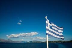 Flagga av Grekland med havet Arkivfoto