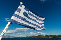 Flagga av Grekland med havet Fotografering för Bildbyråer