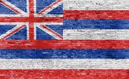 Flagga av Hawaii på tegelstenväggen Arkivbild