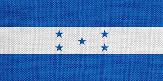 Flagga av Honduras på gammal linne Royaltyfri Bild
