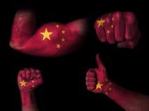 Flagga av Kina på kroppsdelar Arkivbild