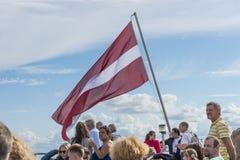 Flagga av Lettland och folk Royaltyfria Foton