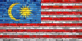 Flagga av Malaysia på en tegelstenvägg royaltyfri illustrationer