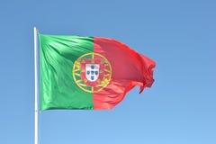 Flagga av Portugal i vinden Royaltyfri Foto