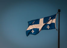 Flagga av Quebec - Fleurdeliséen Fotografering för Bildbyråer