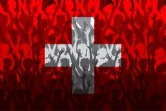Flagga av Schweiz över stöttande fans Royaltyfri Fotografi